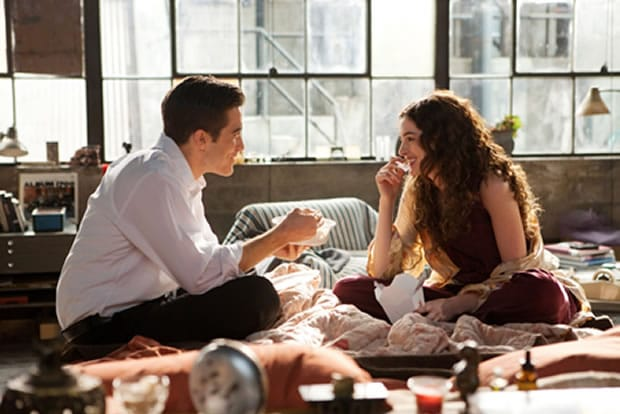love and other drugs couple eating on the bed