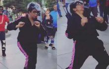 Absolument impossible de tester le sens du rythme de cette mamie qui danse en pleine rue